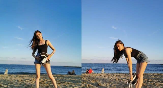 张天爱身处海边美丽的沙滩,美人美景合二为一,非常养眼